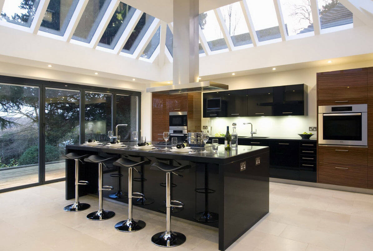 This kitchen pairs soft brown cabinets with richly black wood, thus showcasing yet another kitchen trend. Combining cabinet colors is a trendy look that is holding really strong in best contemporary kitchen designs