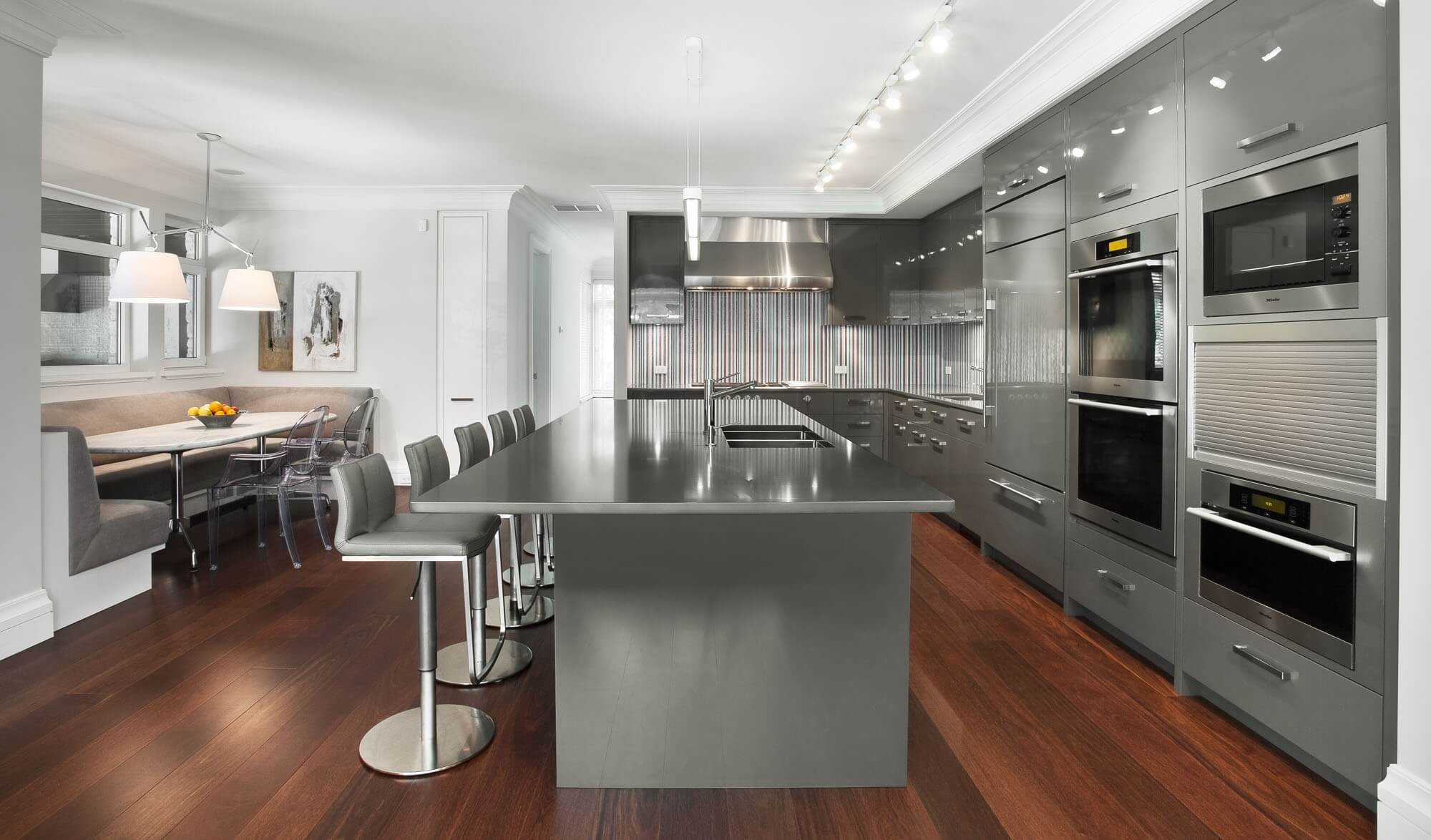 Just like the bowl of fruits, contemporary kitchen bar stools can add a pop of color in a crisp white, sleek black or all–metallic accents kitchen. The stainless steel stool stands match other appliances to provide simple yet elegant look