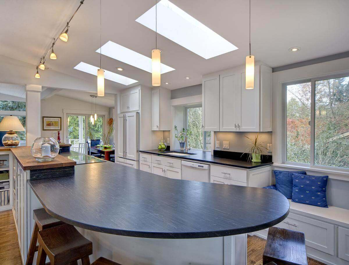It is easy to see from this angle how much extra light has been brought into the space through the contemporary kitchen ceiling lights and the three big skylights. This has indeed resulted in a quite bright space to work in