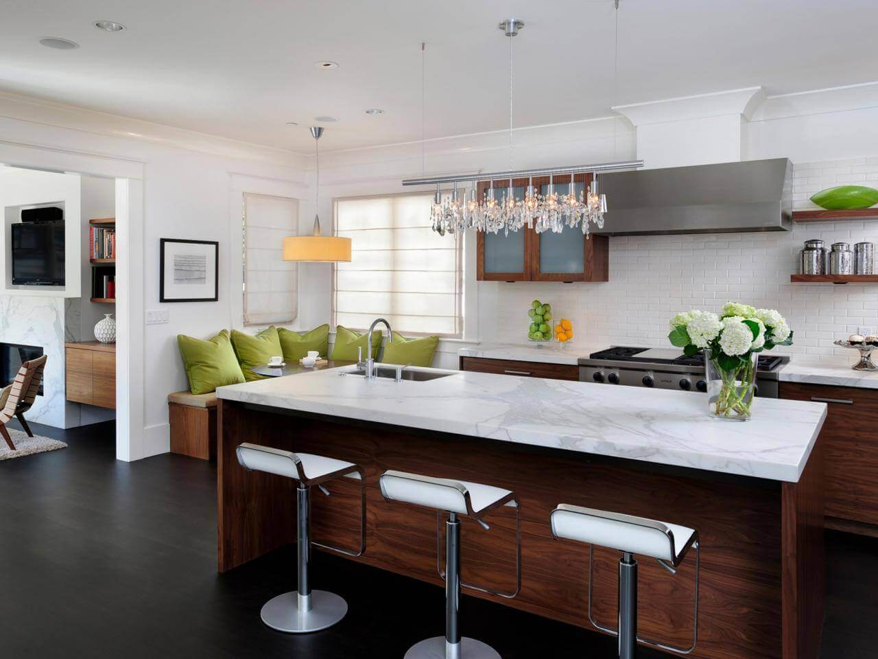 In contemporary kitchen decorating ideas, the importance of open pantry shelving can't be overemphasised. It helps keep ingredients in perfect view and easy to reach. The dark wood island and stainless steel barstools create a casual spot to dine