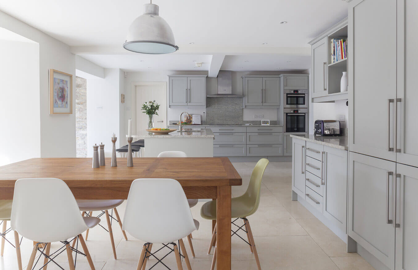 When a kitchen is too pretty, or too practical, it often does not work. Contemporary kitchen design is a blend of both, like this chic yet functional white kitchen with a brown wood contemporary kitchen dining set