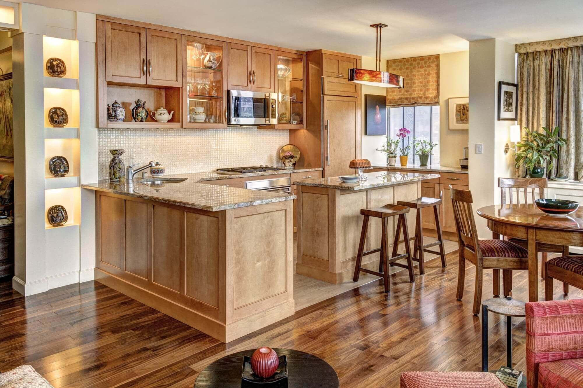 Known for its unique pale gold color, oak is a very tough and hard wood. Its dense grain and coarse makes it highly resistant to damage. This contemporary kitchen with oak cabinets features a wide variety of grain styles, thanks to the natural variations in the wood grain