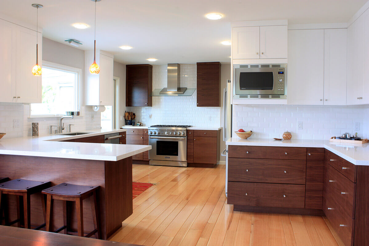 Set the standard for elegant urban living with aluminium appliances and a set of polished distinctive embellishments and accents. Combine these with warm finished contemporary walnut kitchen cabinets to make a space like this that is equal parts modern and inviting