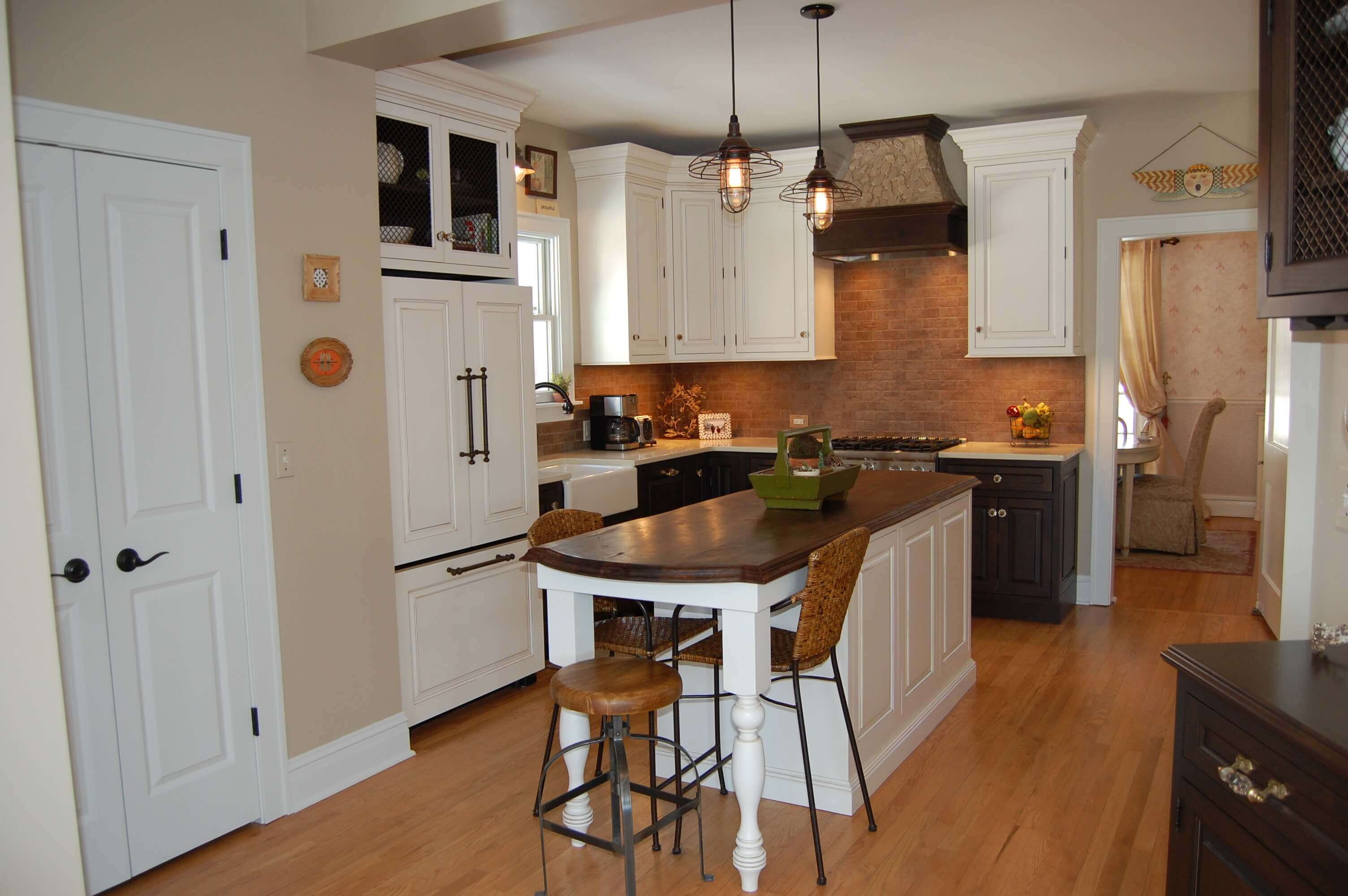 This White Kitchen With Hardwood Flooring Takes Advantage Of Small Kitchen Island Table With Stools Idea