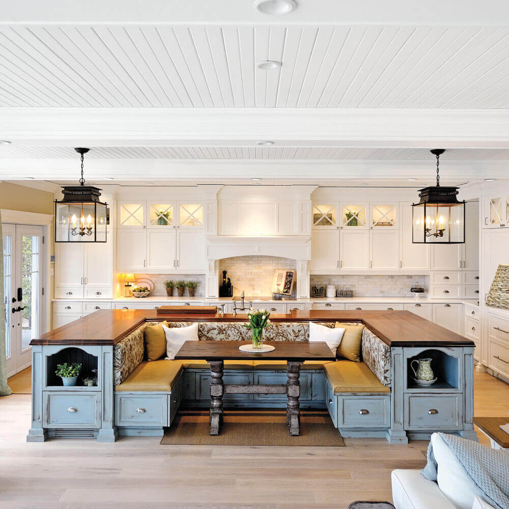With endless varieties of seating options available ranging from practical to comfortable, kitchen islands can be smart, fun, and social. This kitchen island with built in seating adds to the overall functionality and aesthetic appeal of the kitchen