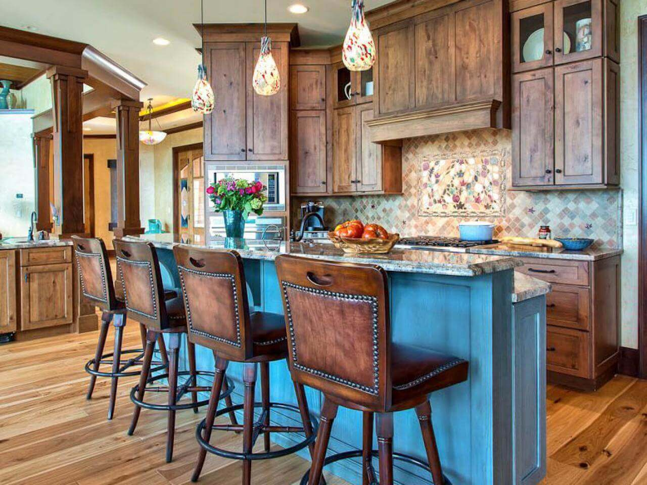 This small kitchen takes wooden décor to the extreme. It features a minimalist kitchen island with chairs that adds a touch of warmth and a modern feel. The four rustic chairs serve a perfect conversation piece