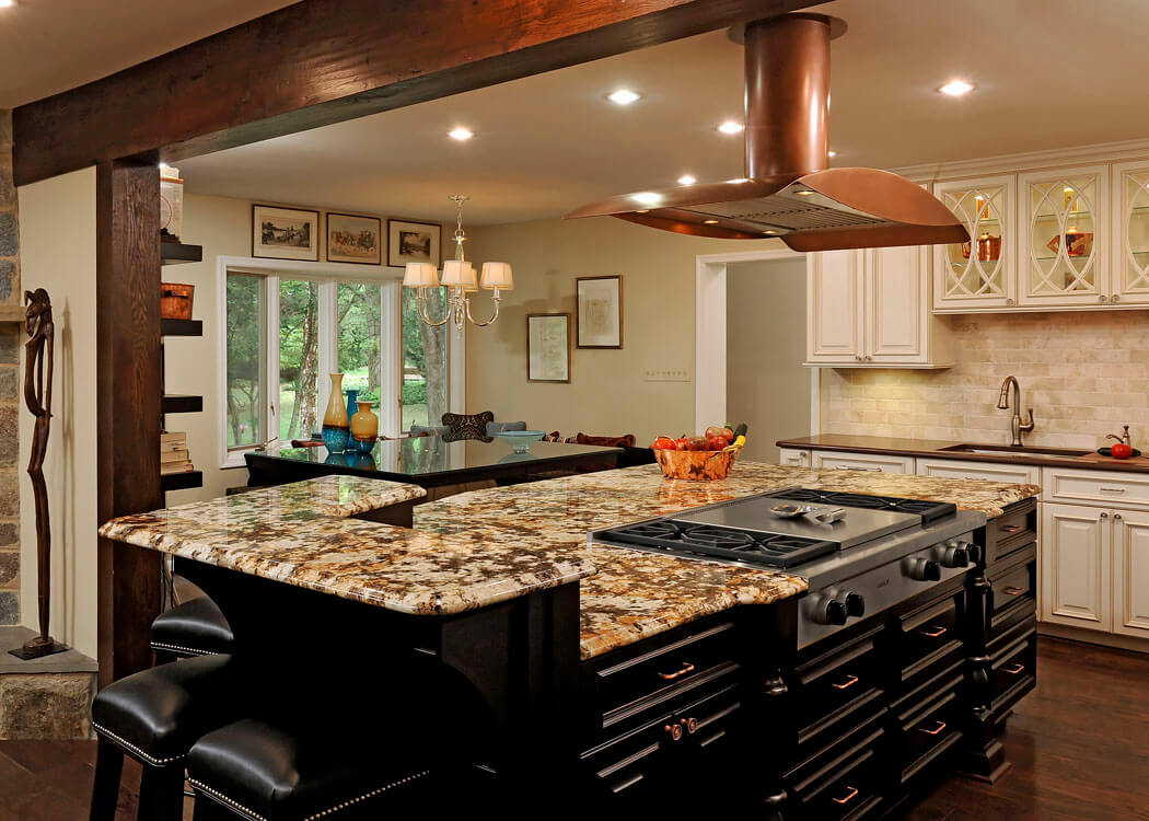 With seating on the breakfast bar side and a stunning granite top, this two–tiered kitchen island with granite top and seating has modern styling. Open space under the counter creates room for legs