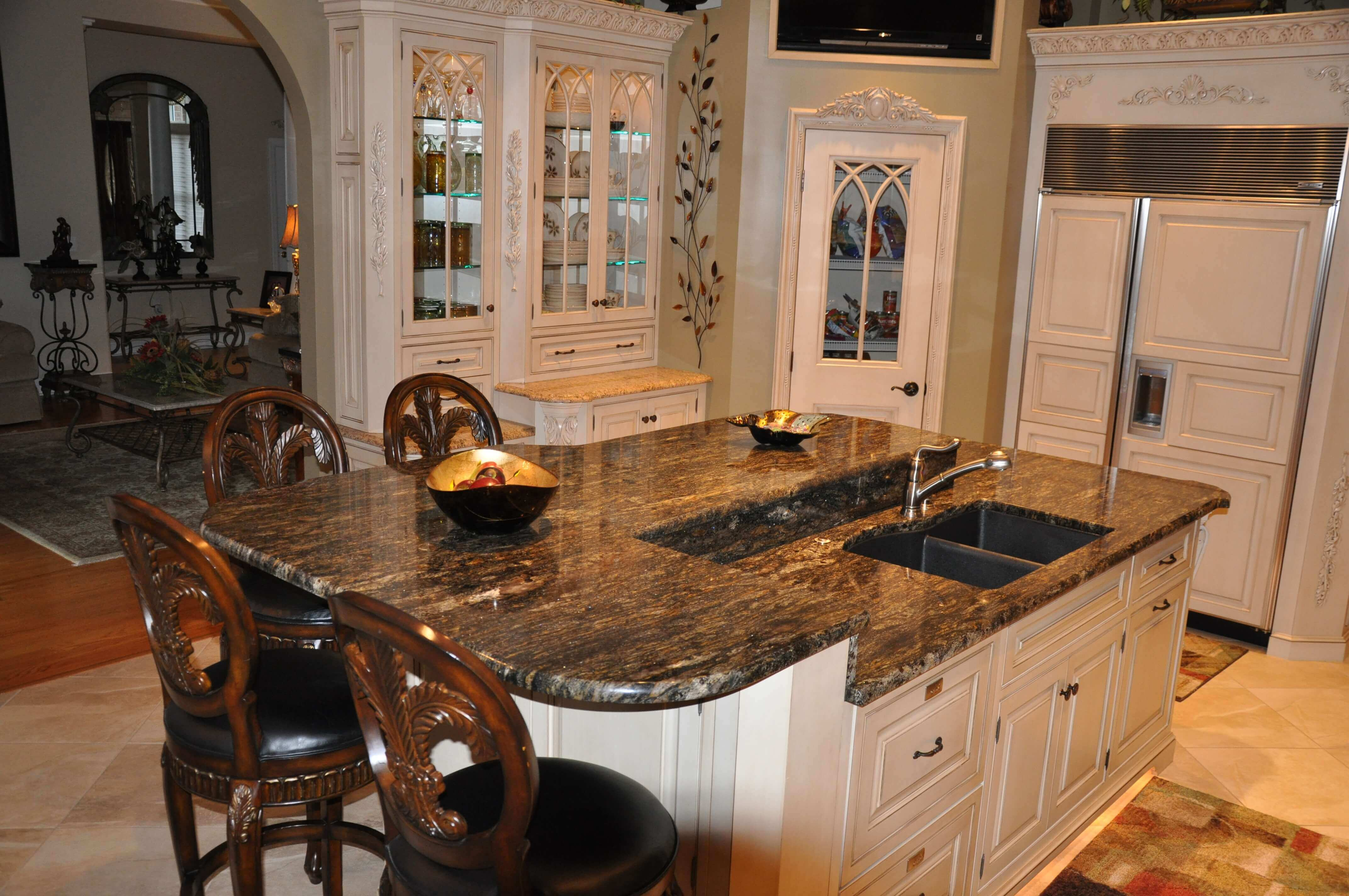 With natural marble top and traditional country styling, this kitchen island with sink offers multiple levels that are both visually interesting and functional. It has a stainless steel faucet and seating for four