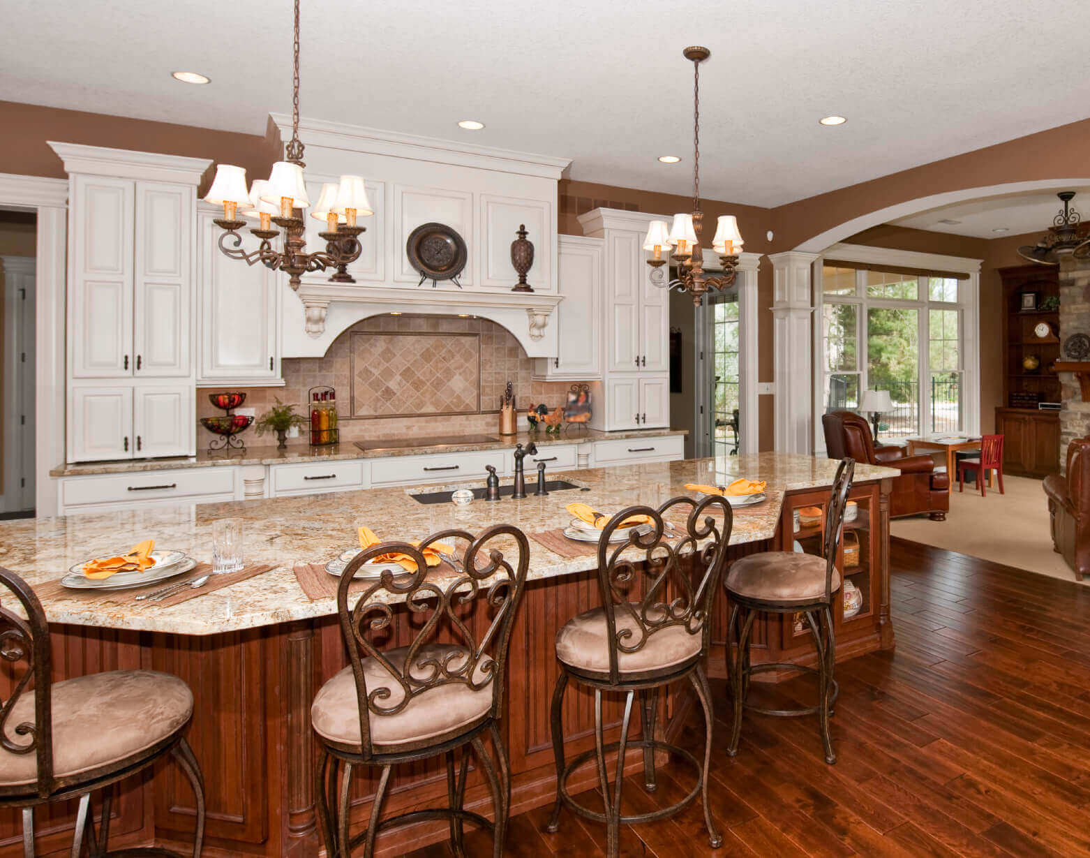 Home to a large sink, recycling bins, and elegant seating for four, this large luxury kitchen island plays hard on special occasions and works hard for the family during the week. It offers plenty of serving space for entertaining