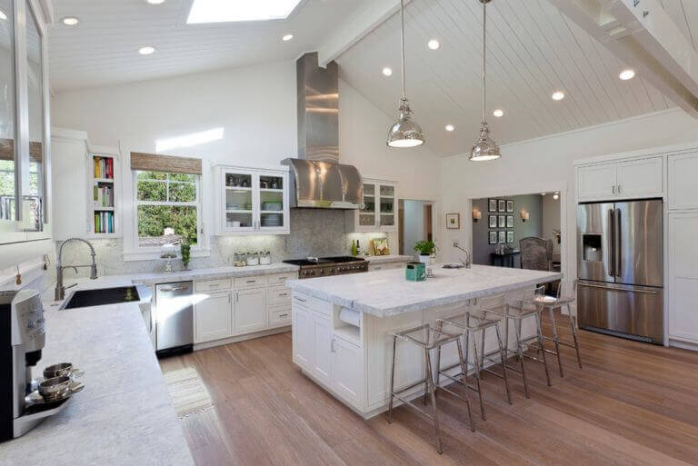 From an expansive skylight to recced lighting fixtures, lighting make this kitchen so inviting. The addition of two chic pendant lighting over the kitchen island adds extra dimension and substance to the space