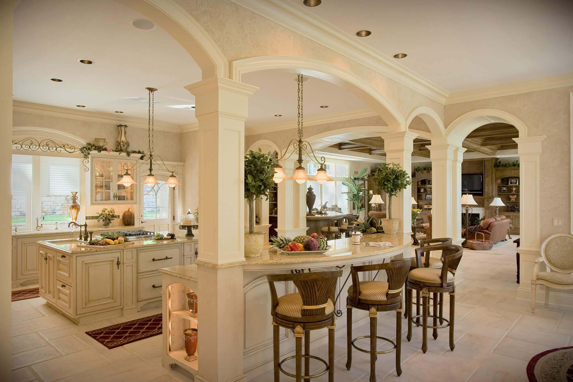This luxury kitchen design with island is set around a centrally positioned centrepiece. The decorative pattern right in the middle of the room brings eyes to the tiled floor. The white and cream color scheme offers a sense of splendor and luxury