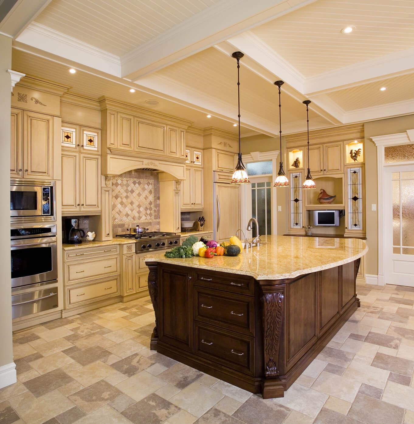 A high–end kitchen design in cream hue is always a great choice. Beige stone granite countertops look fantabulous and are nicely combined with luxury kitchen floor tiles and other cabinets painted in cream