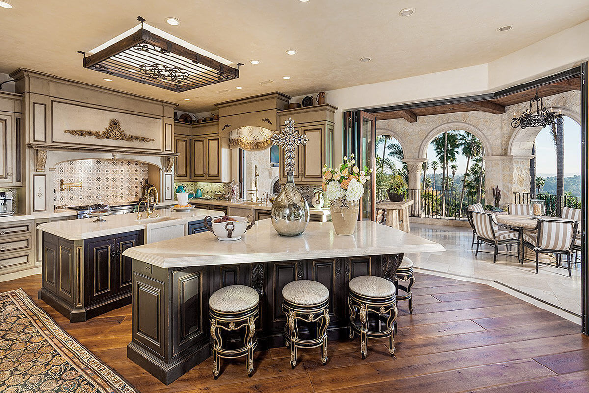The elegant designs of this expansive modern contemporary kitchen mean that meals around the islands feel as wonderful as in many modern apartment dining rooms. The stately crafted wood floor gives the space a hint of rustic charm