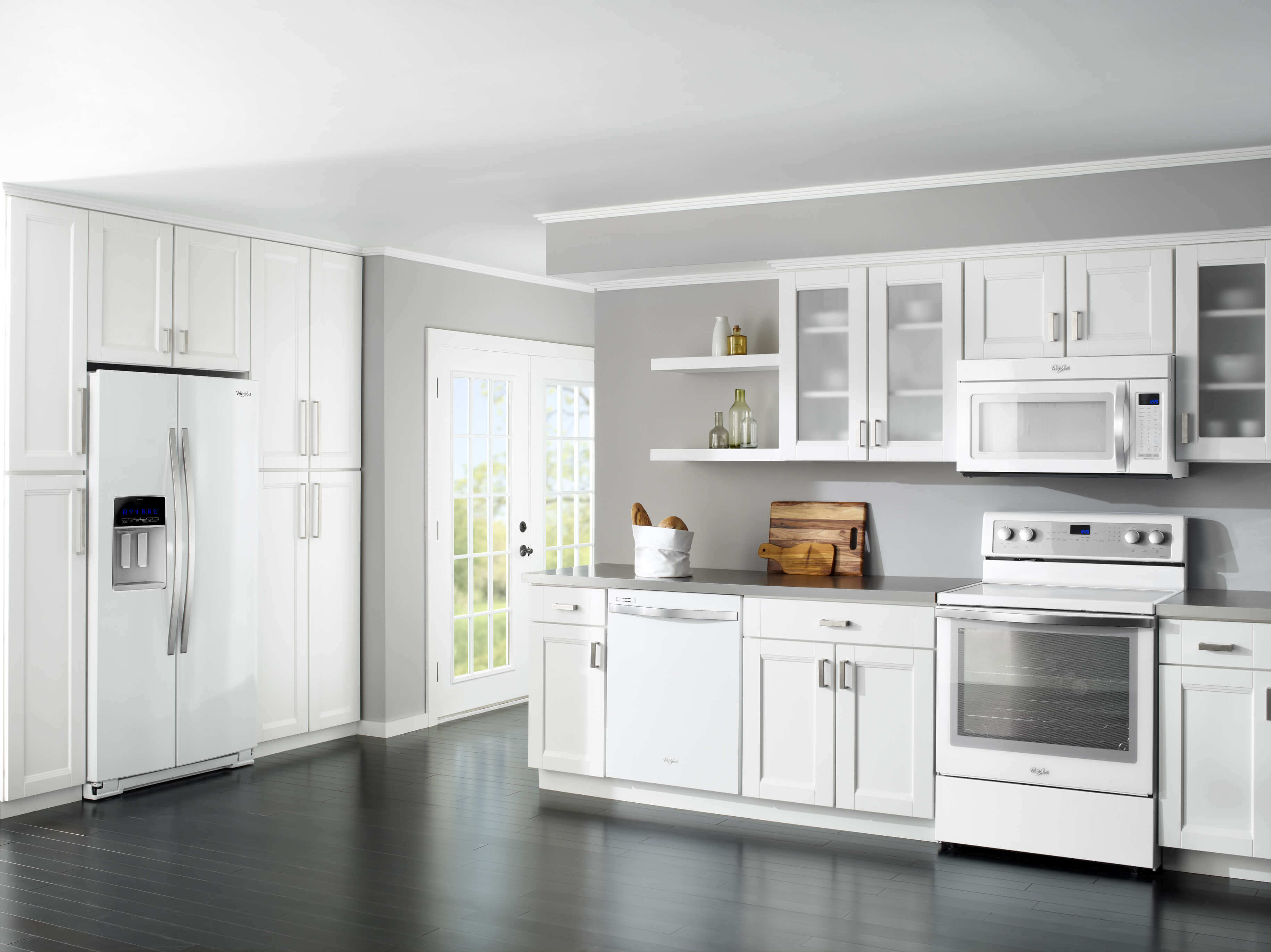 The feature of this modern kitchen design with white appliances is clear at the first look. The ultra–modern white appliances finish the look of the space by adding yet another touch of modernism to the entire design
