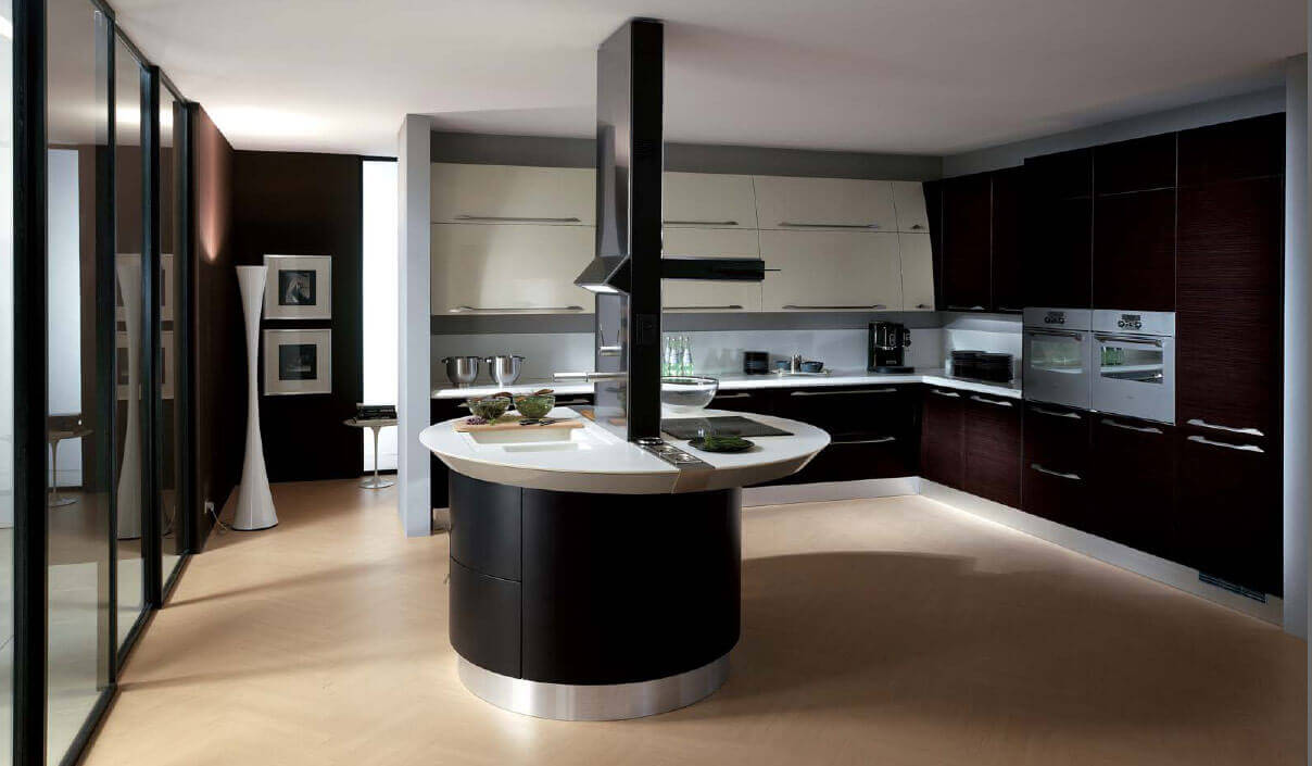 The true feature of this modern kitchen design with island is the custom island. The round base of polished steel continues the elegant theme of the space, while the dark base of the island adds a nice contrasting scheme to the dark brown cabinets