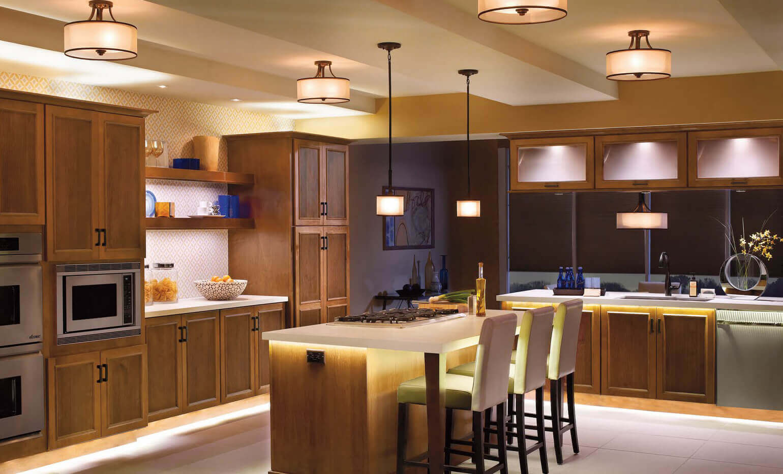 A mix of dark and light wood cabinets throughout this space stands out in contrast from the white backdrop. The real eye catcher however, is the medium sized modern kitchen light fixtures that add to the modern ambiance