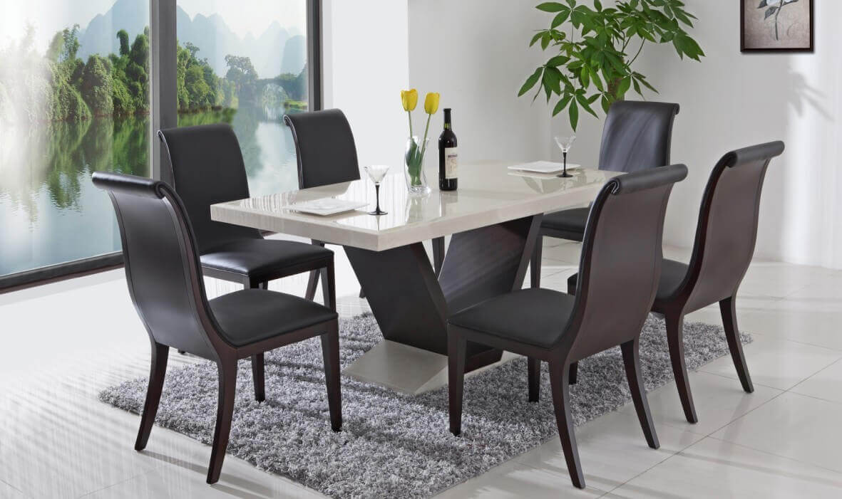One important element for a modern kitchen design is modern kitchen table and chairs. The black chairs have a modern look and complement the finish of the table. They offer a sophisticated style that balances out the theme of the entire room