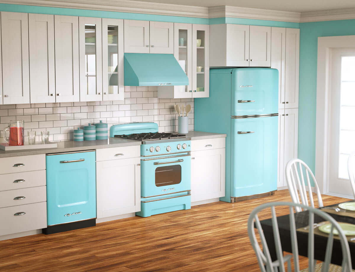 The contrast in this modern kitchen vintage style is what actually brings the space together. Pops of color burst from a blue and white scene. The light brown hardwood floor balances out the space