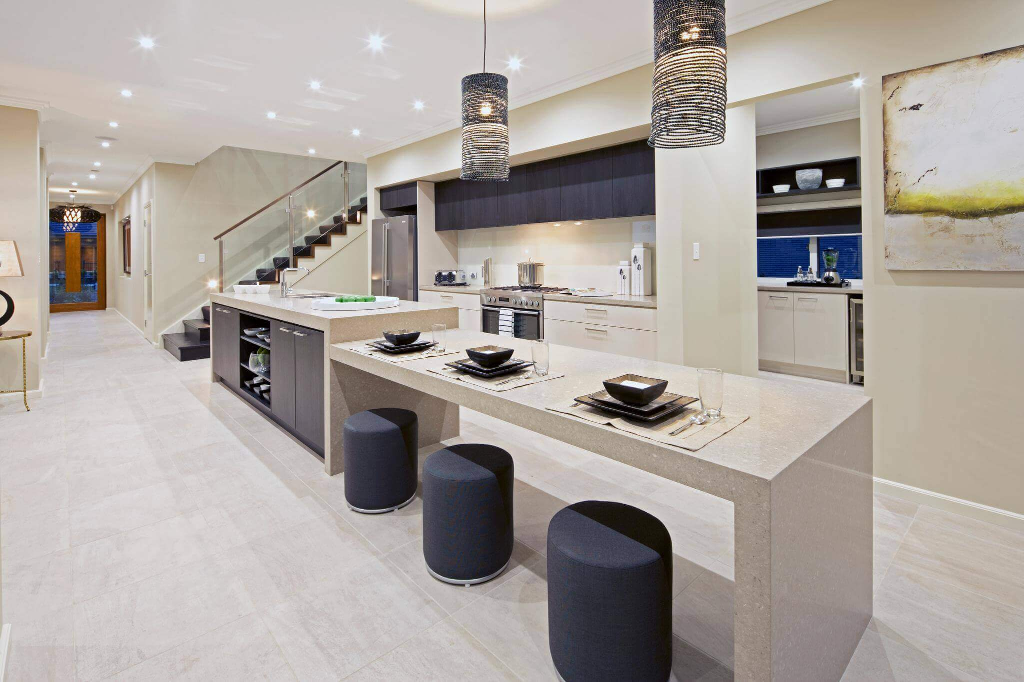 Efficient space usage as a design element is fundamental in modern kitchen designs. This modern kitchen with butlers pantry demonstrates how a space can retain its full functionality without detracting from the design focus