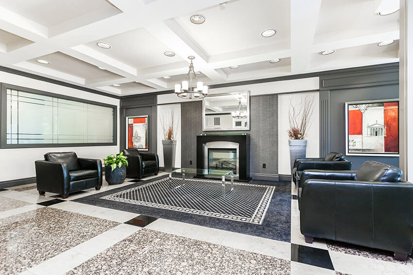 Contemporary Living Room Design With Black Leather Armchairs With Modern Fireplace And Polished Granite Floors