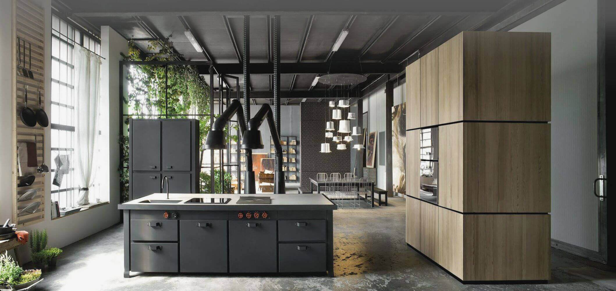The invested details in this room personalize the grandeur and otherwise create a comfortable kitchen space. Dark wood island with sink adds a natural touch in contrast to the light wood modern industrial kitchen cabinets