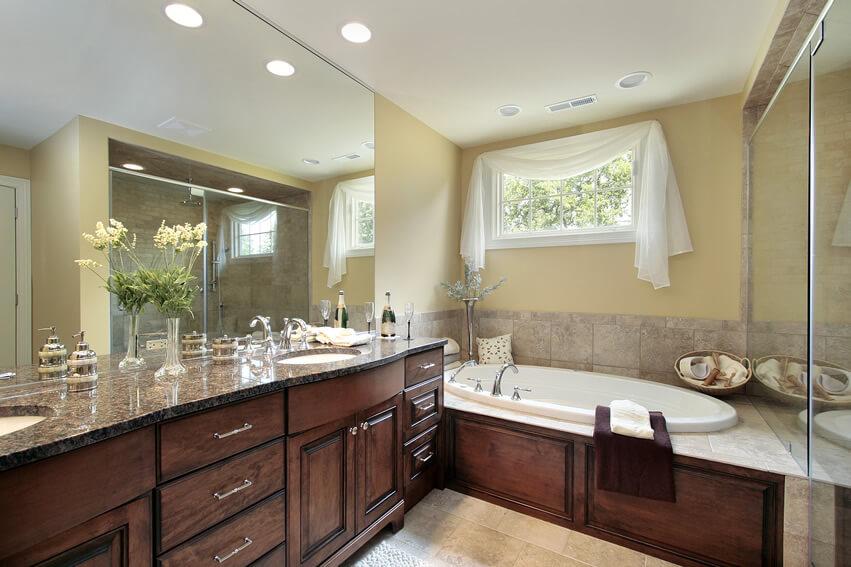 Bath granite counter yellow wall brown cabinets