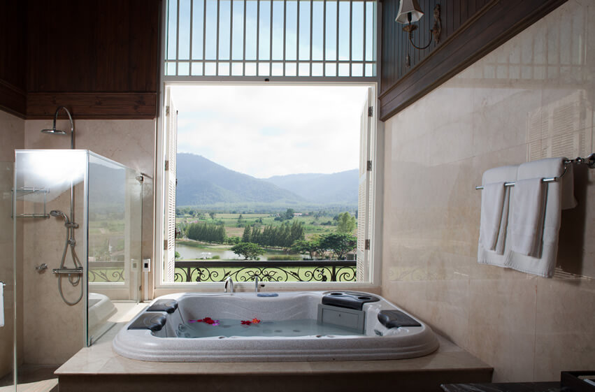 Bath soaking tub country river view