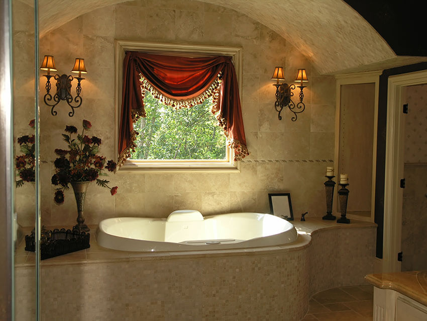 bathroom suite with relaxing bathtub