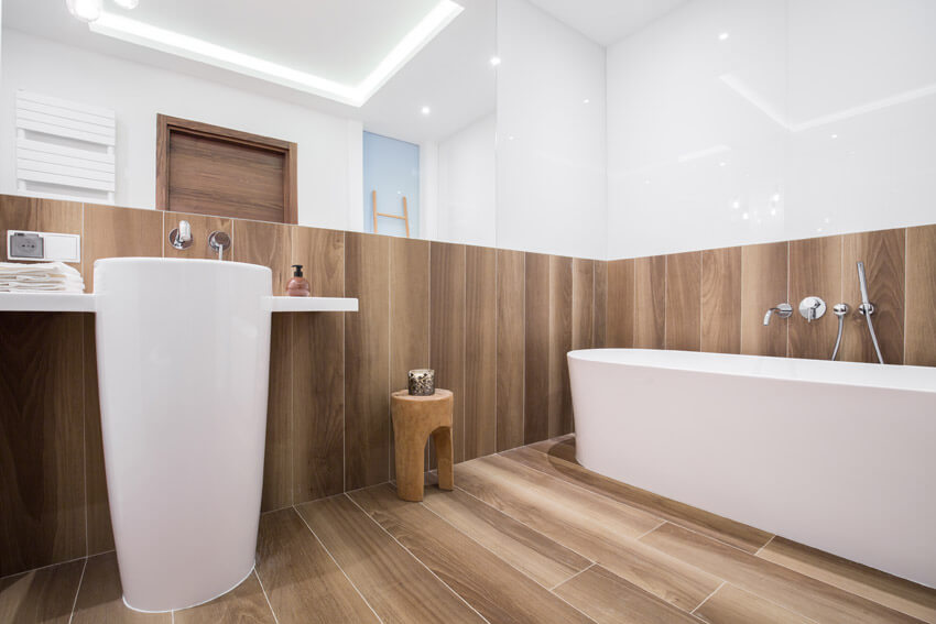 bathroom with wood accents and flooring