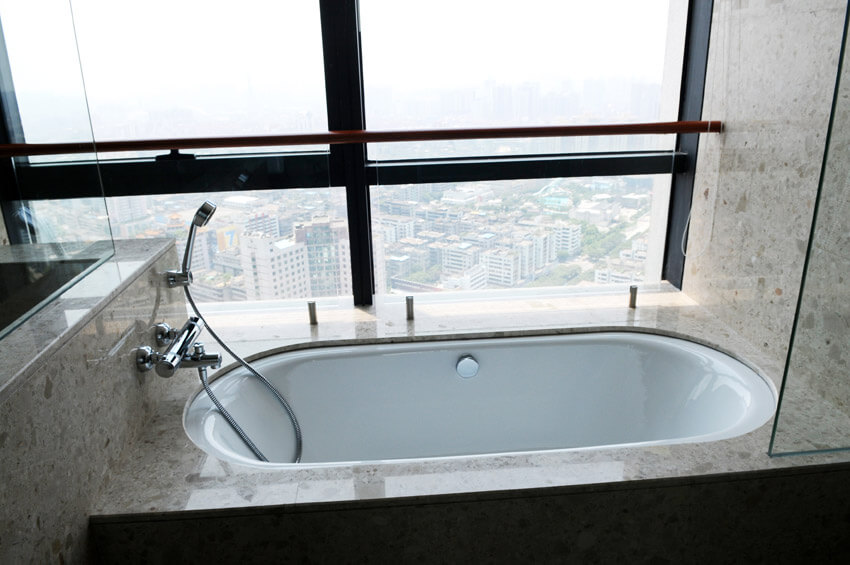 bathtub with amazing city view from penthouse