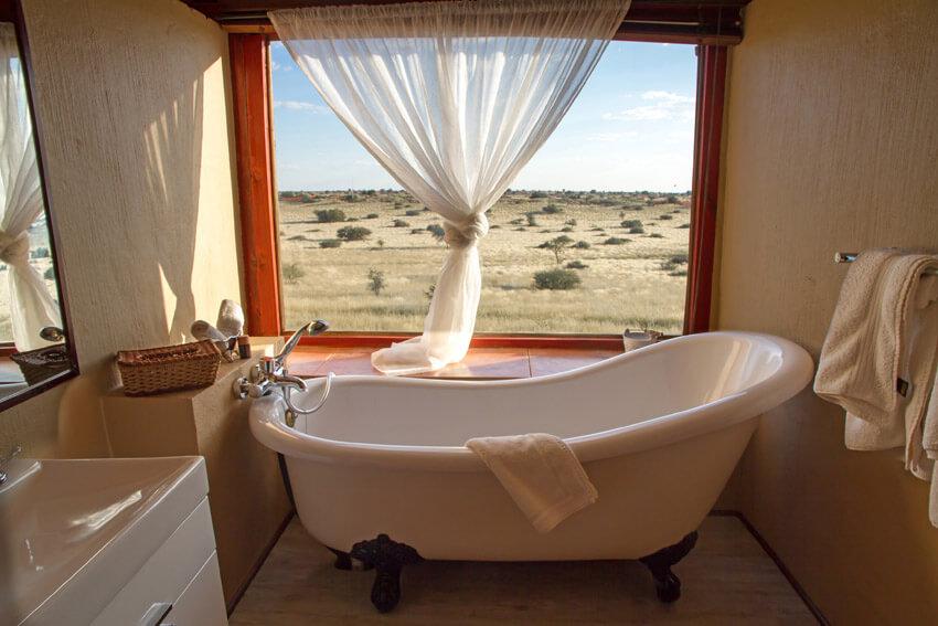 bathtub with beautiful view from window
