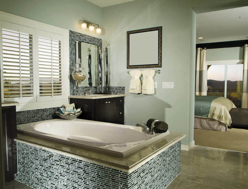 bathtub with intricate tile work