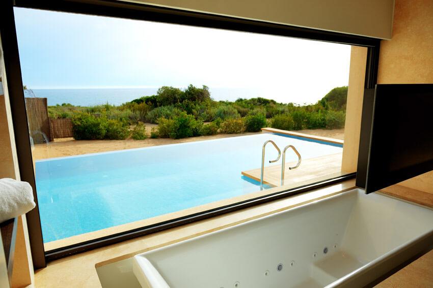 bathtub with pool view