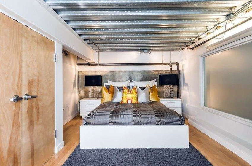 Bedroom Loft with Aluminum Ceiling and Light Wood Flooring
