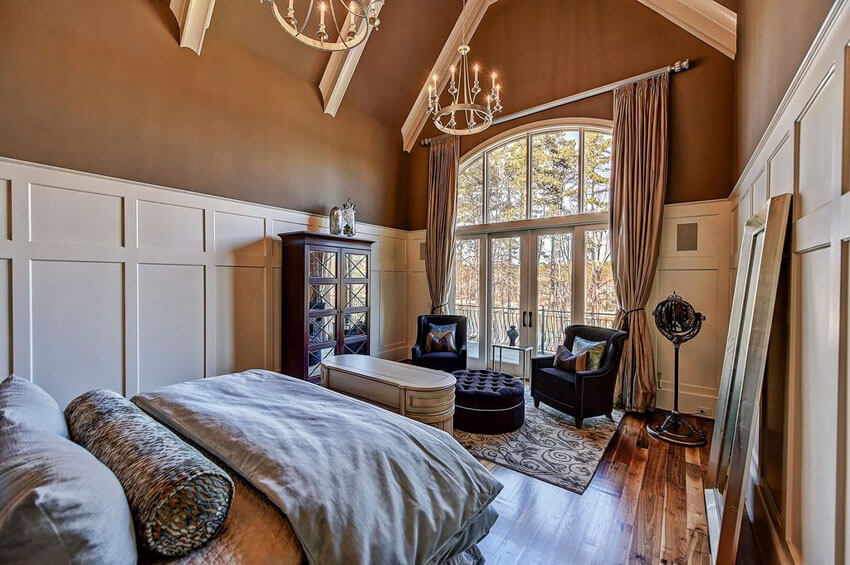Many contemporary bedroom designs don't really require fat budget to implement, and they make great impacts. In this bedroom with american walnut floors and two chandeliers, stained walnut wood flooring is a stark contrast against the bedroom sheets and white wall panels