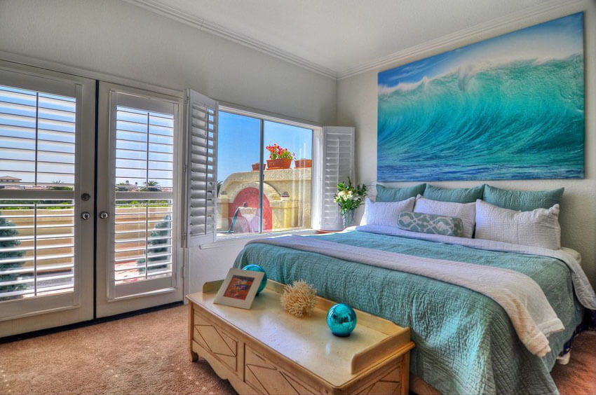 Genial Bedroom With Ocean Wall Art Teal Bed Covers And White Plantation Shutters