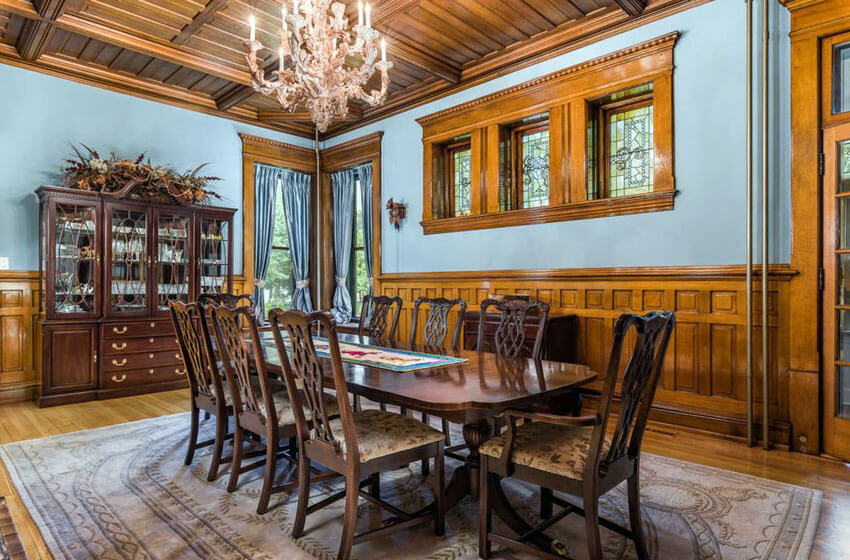 Blue painted craftsman dining room with wood wainscoting