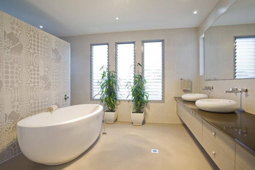 Bright master bath dual sinks minimal design