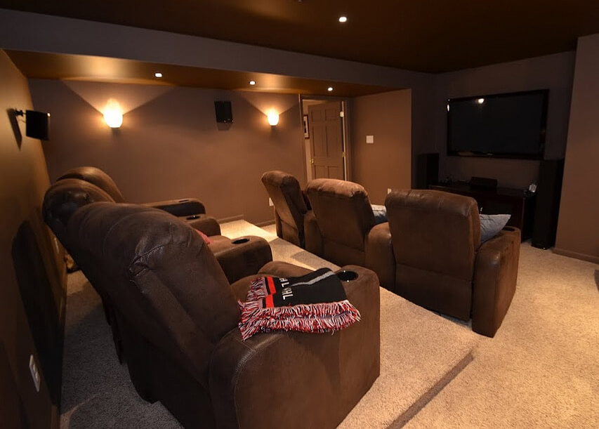 Brown Themed Home Theater With Comfortable Seats