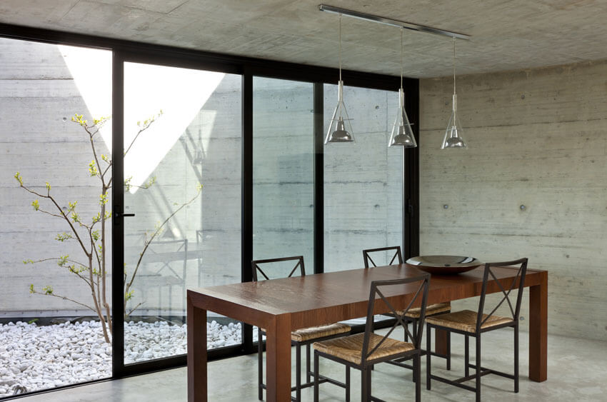 concrete dining room with wood table