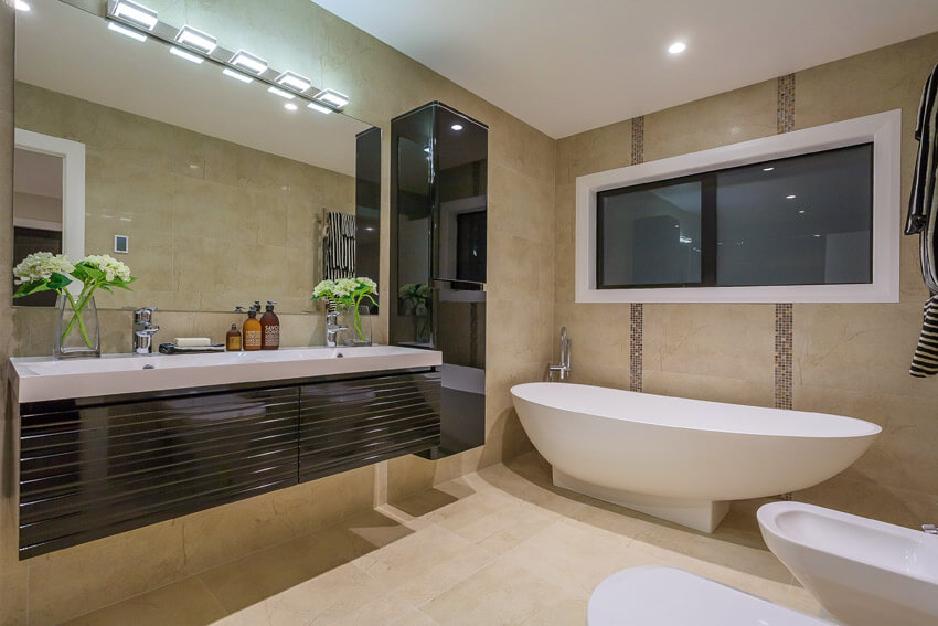 contemporary bathroom with long curved tub