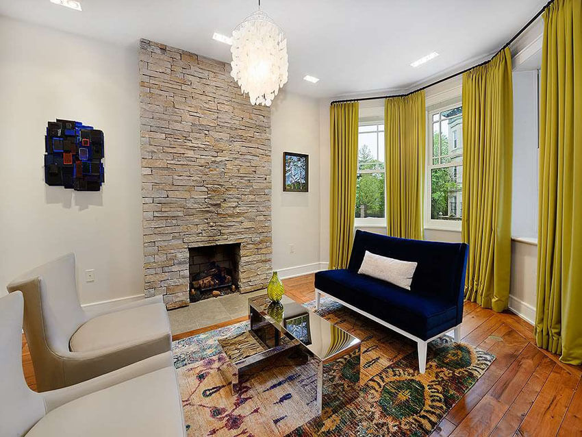Contemporary Living Room With Chandelier And Stone Fireplace