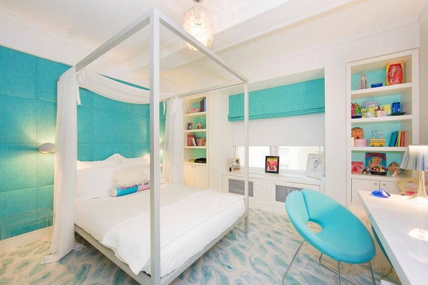 The teal work chair and drapes give this minimalist contemporary teal bedroom with fabric walls modern high post bed and tray ceiling important pops of color. The teal padded back wall, and patterned white and teal carpet add to the quirkiness of the space
