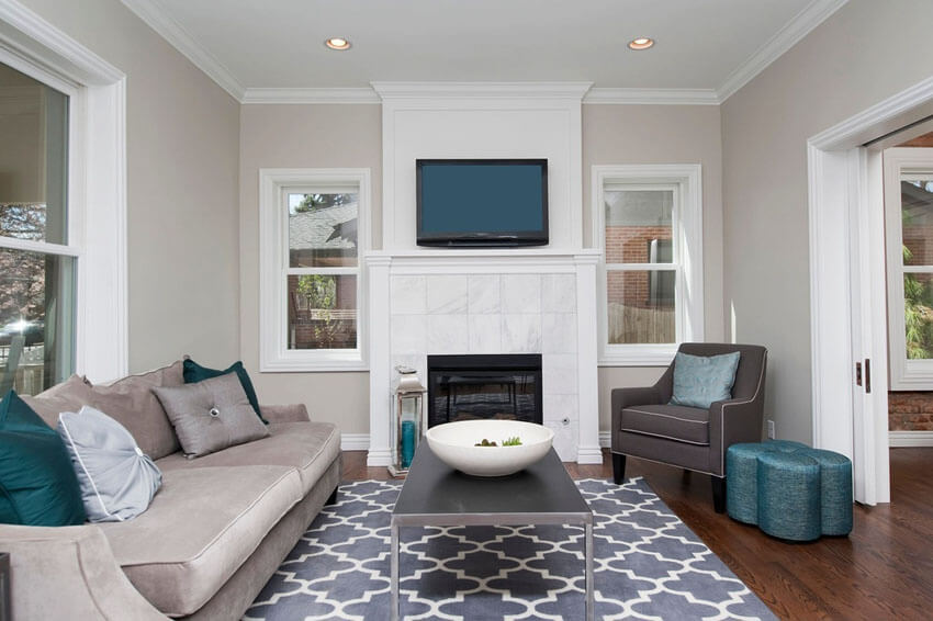 Cozy Contemporary Living Room With Carrara Marble Fireplace And Wood Floors