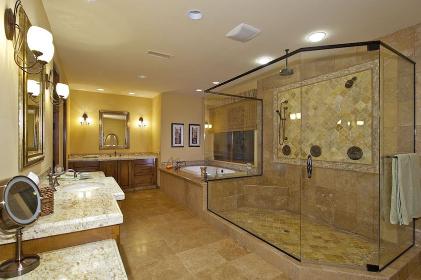 craftsman bathroom with bronze frame shower travertine tile granite counter and wood cabinetry