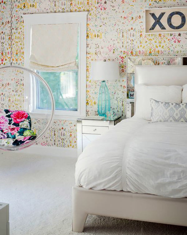 The see through bubble hanging chair makes a useful addition to this cute girls bedroom with bubble hanging chair. The chair incorporates throw pillows on the seat that nicely accent the light floral patterned wall paper