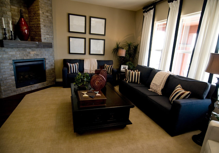 Dark Sofa In Living Room With Tan Area Rug