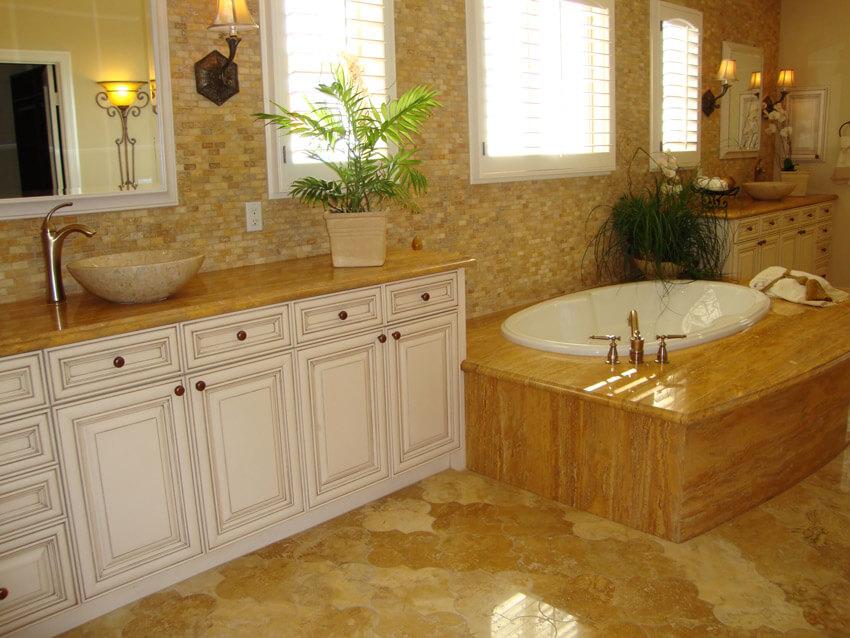 elegant luxury bathroom with white cabinet tan tile