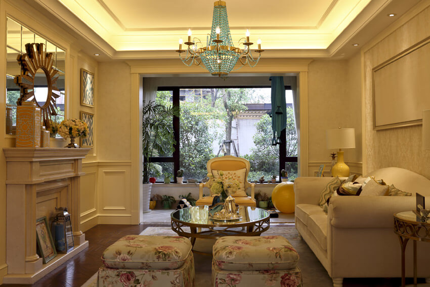 Formal Living Room With Large Tray Ceiling And Chandelier
