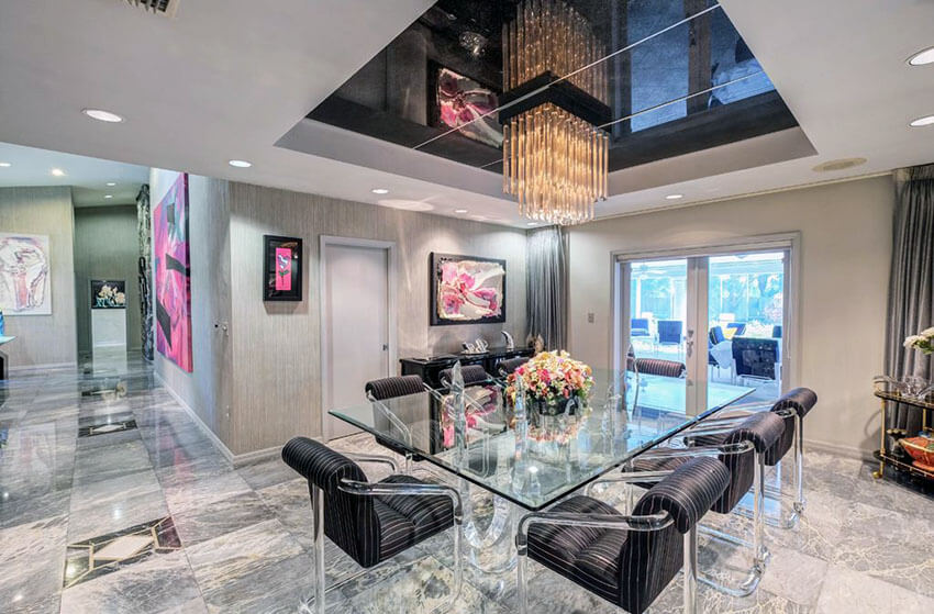 glam modern dining room with marble floors and tray ceiling